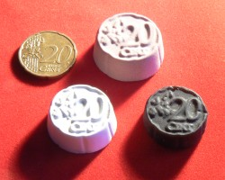 All four versions: coin, plaster, tooling board and candy