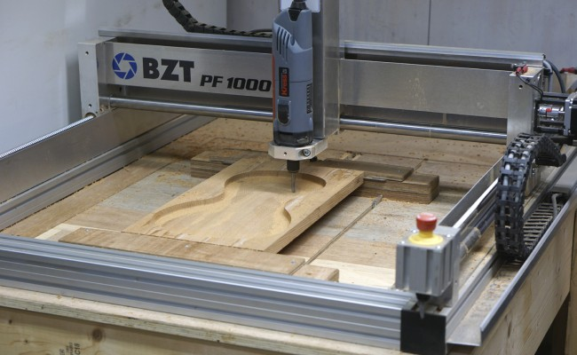 BZT machine milling a violin bottom plate
