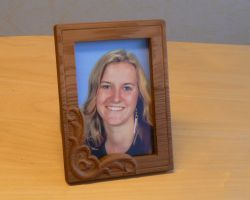 Wooden picutre fram with photo of girl