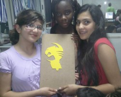 Three students showing the logo