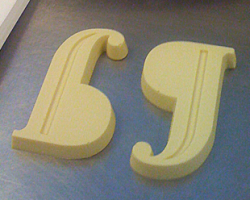 Two Pilcrow characters in white chocolate