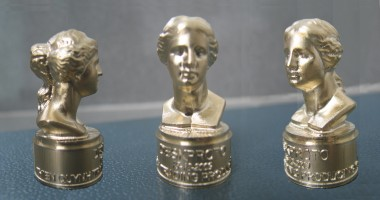 Three views of a small Venus model in brass