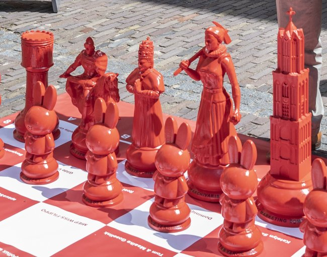 Some red chess pieces in closer view