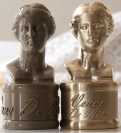 TwoVenus sculptures in brass