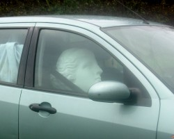 Large Venus sculpture in a car